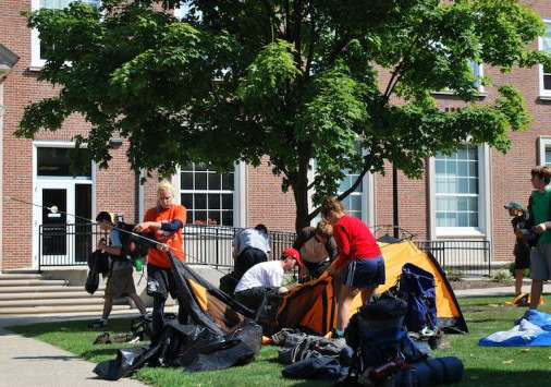 Students packing tents
